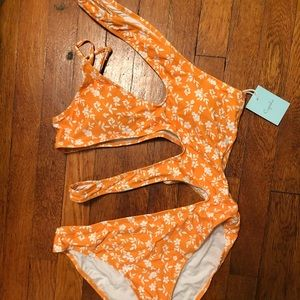 One piece bathing suit with cutouts